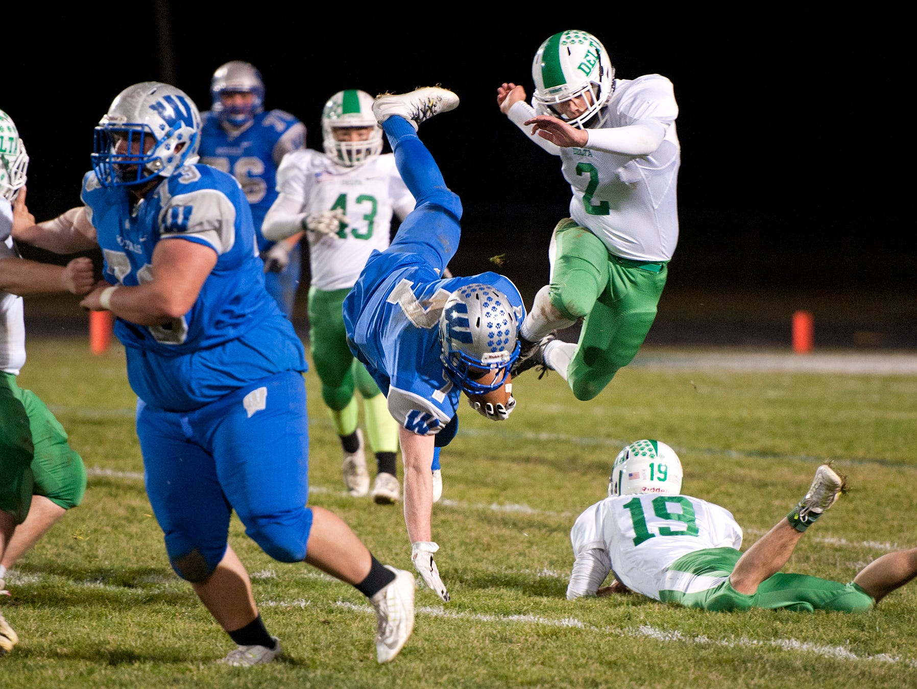 Wynford's Nick Looker is tripped up by Delta's defense.