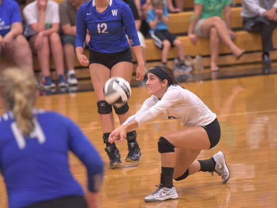 Wynford's Bailey Alspach passes the ball Tuesday evening.
