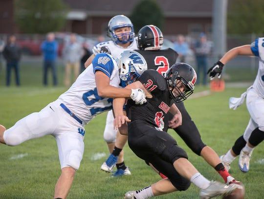 Wynford linebacker Cole Heinlen disrupts Mohawk kicker