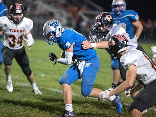Wynford's Joel Griffin sheds a Seneca East tackler.