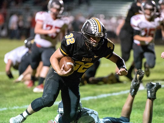 Colonel Crawford's Dylan Knisely runs the ball into
