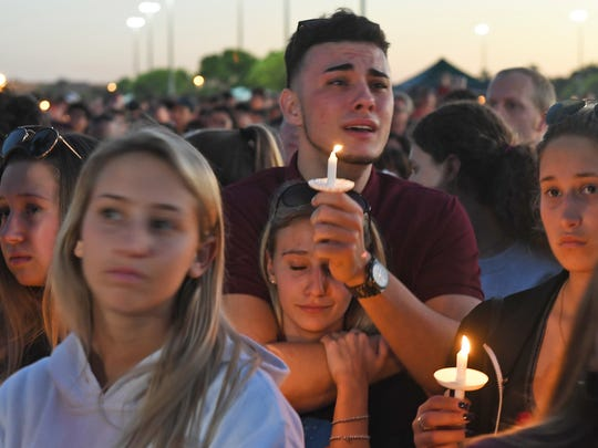 Mourners gather at a vigil that was held for the victims