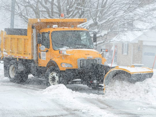 A Springettsbury Township snow plow clears snow from