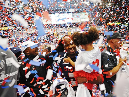 The Storm's Chris Dixon celebrates with his daughter, Lailah Dixon, 3, after defeating the Nebraska Danger 63 to 46 during the 2014 IFL United Bowl Championship on Saturday, June 28, 2014, at the Sioux Falls Arena in Sioux Falls, S.D.
