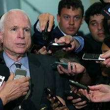 Sen. John McCain, R-Ariz., talks to reporters.