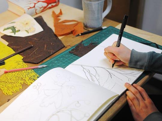 Jordan Thornton sketches while working in her studio