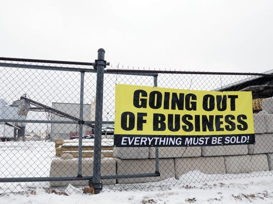 A sign declaring the closure of Port Huron Building Supply is hung for passing motorists Monday, Feb. 15, in Port Huron.