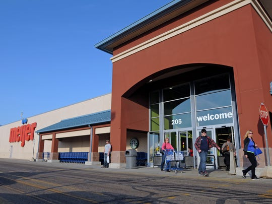 Customers exit from shoppinh Monday, Mar. 7, at the Meijer in Marysville.