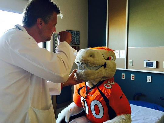 Emergency physician Dr. Jamie Teumer checks out Denver Broncos mascot Miles at the Oct. 24 Teddy Bear Hospital event at the new UCHealth Emergency Room in Fort Collins. The good news is Miles is on the mend.