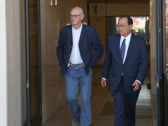 John Wessman, left, leaves the Larson Justice Center in Indio, June 30, 2017.