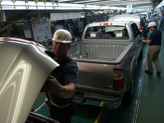 In this file photo, workers check for defects at a Toyota plant in Princeton, Ind.