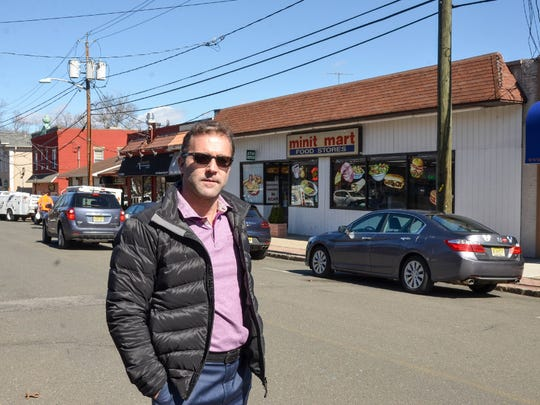 Councilman Anthony Volpe stands  in the middle of Terrace Street, which the council has just authorized to put the bids out for the streetscape at the June 13 council meeting.