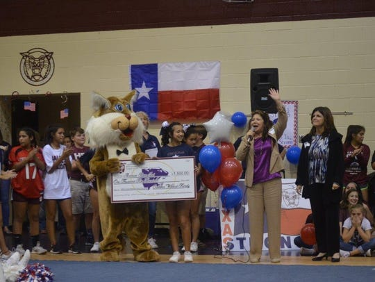 Willie the Wildcat (from left); Tori Ayala, Student Council president; Naomi Freeze; and Shelley Dominguez