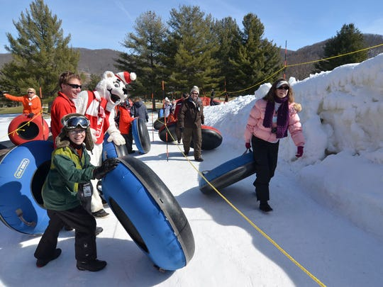 The Sugar Mountain Ski Resort tube run is open 10 a.m.-10 p.m. with night lights on its 700-foot slope.