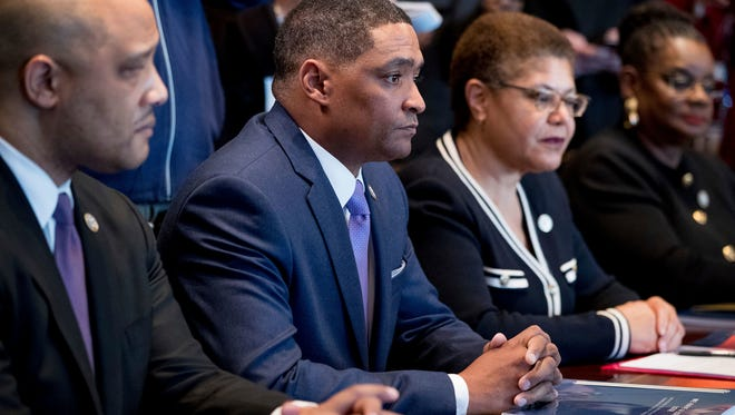 From left, Rep. Andre Carson, D-Ind., Congressional Black Caucus Rep. Cedric Richmond, D-La., Rep. Karen Bass, D-Calif., Rep. Gwen Moore, D-Wis., and other members of the Congressional Black Caucus meet with President Donald Trump in the Cabinet Room of the White House in Washington, Wednesday, March 22, 2017. (AP Photo/Andrew Harnik) ORG XMIT: DCAH107