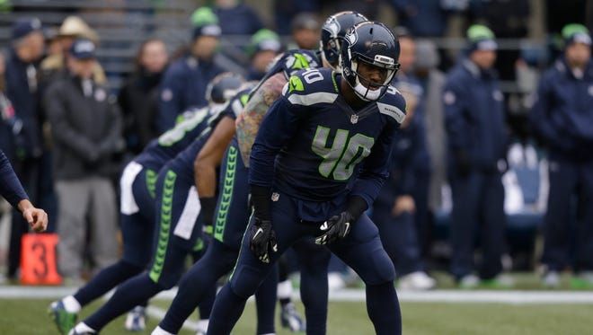Seattle Seahawks' Derrick Coleman and teammates line-up for the opening kick against the St. Louis Rams to start the first half of an NFL football game, Sunday, Dec. 27, 2015, in Seattle.