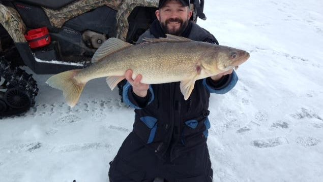 Aron Kastern with a monster walleye caught with guide Jeff Evans in December 2014.