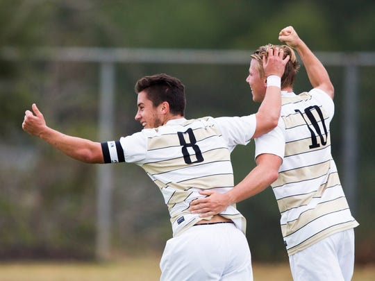 Anderson University senior midfielder Brad Du Plooy and Anderson University senior forward Lars Kaula celebrate after Kaula scored the first goal of the game against Brevard off of an assist made by Du Plooy on Wednesday, September 21, 2016 in Anderson.
