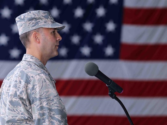 Col. Donald R. Bevis addresses Airmen and family during a welcome home and departure ceremony Saturday at the Air National Guard Base main hangar in New Castle Delaware.