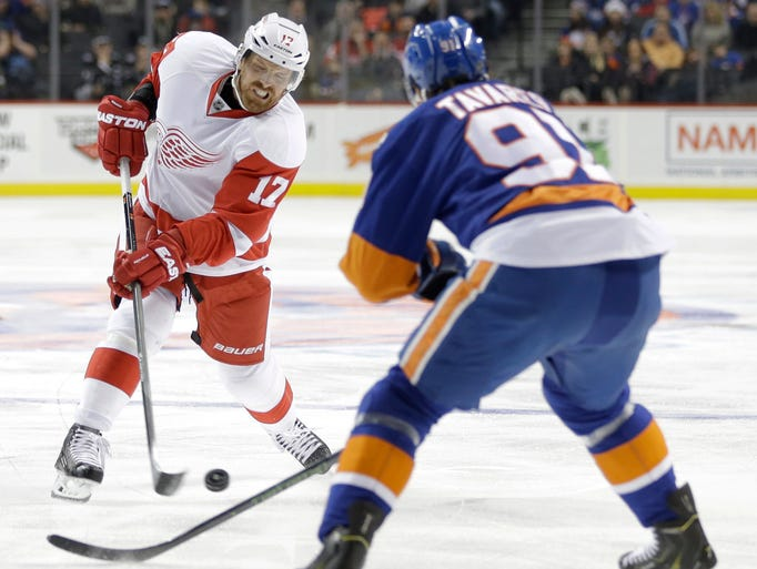Detroit Red Wings' Brad Richards, left, takes a shot