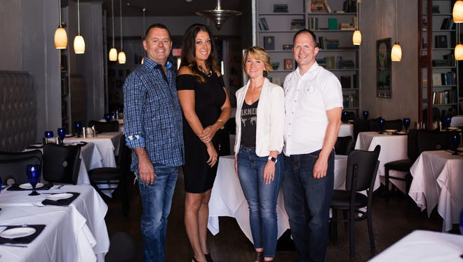 (from left to right) Chef David Albright and his wife, Julie, agreed to sell The Left Bank Restaurant and Bar to Mandy Arnold and her husband, Chef Sean. (Photo by Caleb Robertson)