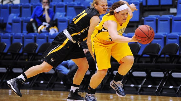 Augustana's Allie Koehn (34) steals the ball from Wayne