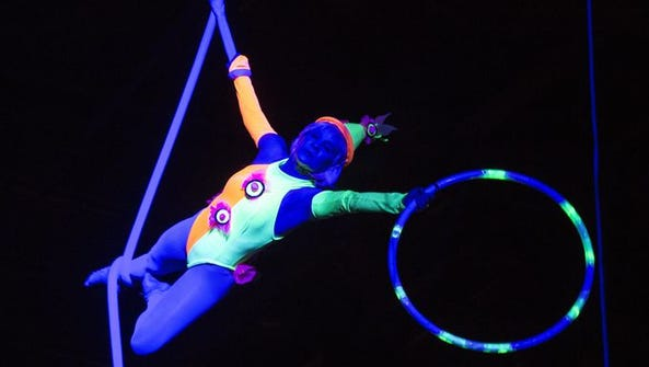 Aerialist performers under black lights wowed the audience