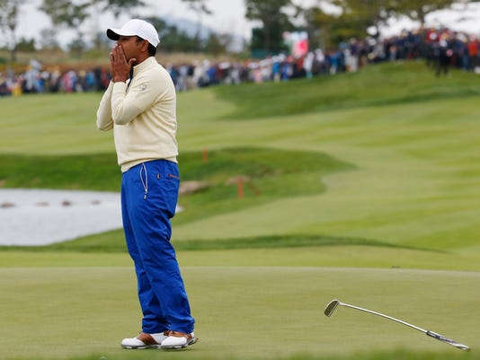 International team player Anirban Lahiri of India reacts on the 18th green after losing his match against United States' Chris Kirk in their singles match at the Presidents Cup golf tournament at the Jack Nicklaus Golf Club Korea, in Incheon, South Korea, Sunday, Oct. 11, 2015.(AP Photo/Lee Jin-man)