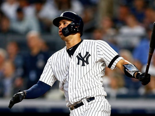 New York Yankees' Gary Sanchez watches his solo home run during the fourth inning of the team's baseball game against the Houston Astros on Thursday, June 20, 2019, in New York. (AP Photo/Adam Hunger)