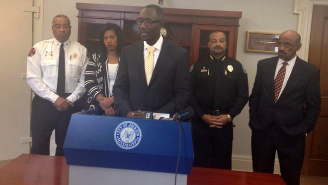 Jackson Mayor Tony Yarber (center) announced Thursday that he will declare a state of emergency for streets and infrastructure.