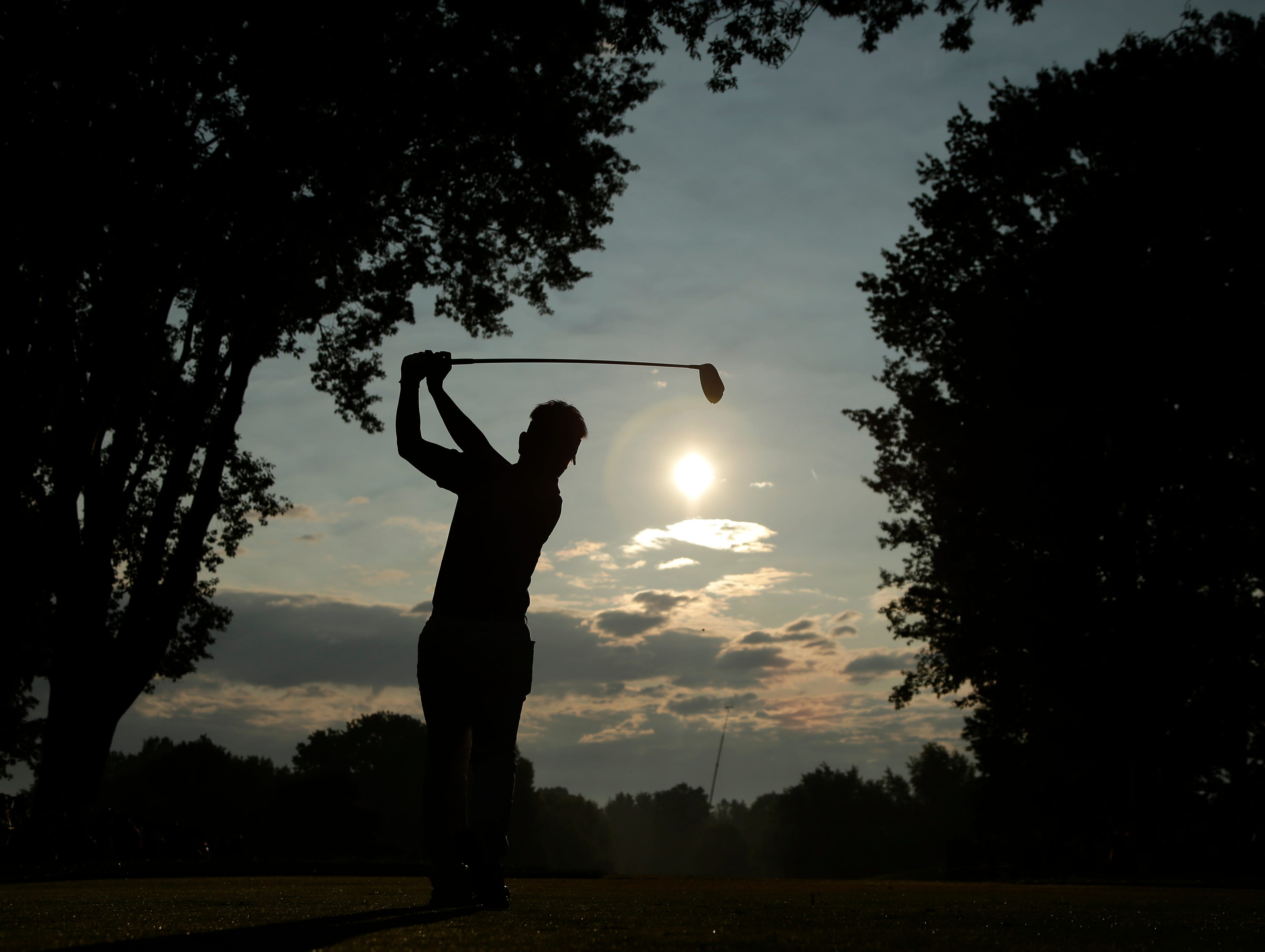 Hiroyuki Fujita, of Japan, tees off on the 10th hole during the first round of the PGA Championship golf tournament at Oak Hill Country Club.