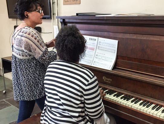 Nancy Hart gives piano lessons to Angela Darwiche-Smith
