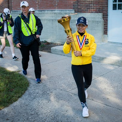Delyn Harty-Isom exits the Muncie Fieldhouse with the