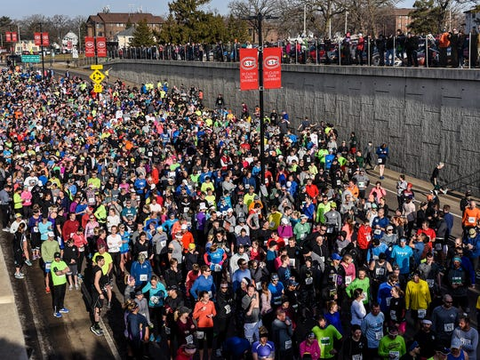 Runners get ready for the start of the Earth Day Half Marathon Saturday, April 21, in St. Cloud.
