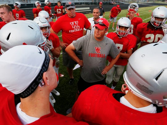 West Lafayette coach Shane Fry meets with his players