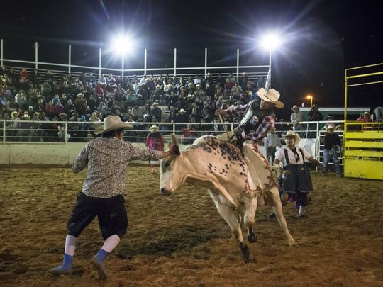 A rider attempts to hang on for the eight seconds needed to advance in the 15th Annual Kenny Young Bull Riding Classic in Page.
