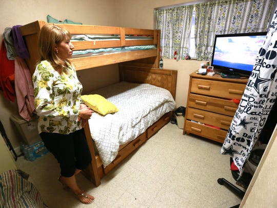 Teresa Miller visited a room where she lived during her 1 1/2-year stay at La Posada.