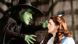 "Margaret Hamilton and Judy Garland in ""The Wizard of Oz."""