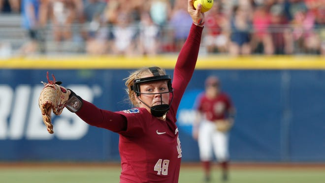 Florida State starting pitcher Meghan King throws in the first inning of the first softball game of the best-of-three championship series against Washington in the NCAA Women's College World Series in Oklahoma City, Monday, June 4, 2018. (AP Photo/Sue Ogrocki)