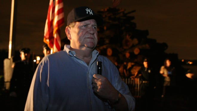 Jerry Donnellan, director of the Rockland Veterans Service Agency, speaks during the Watchfire vigil held by Chapter 333 of the Vietnam Veterans of America on the Piermont Pier May 30, 2009.