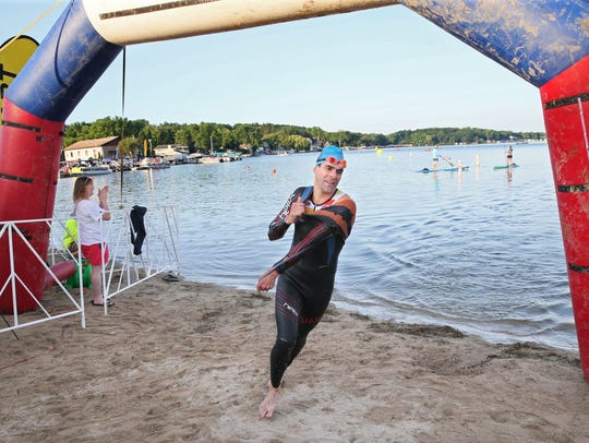 Pewaukee Lake's home to the Pewaukee Triathlon Sunday.