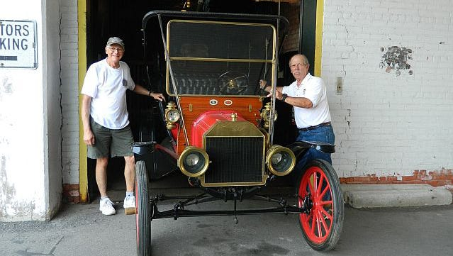 Piquette Ave Plant volunteer Barry Cogan (right)andboardmember Steve Shotwell load therare 1909 Model T into the freight elevator at thePiquette Plant in Midtown Detroit, where the car was built.