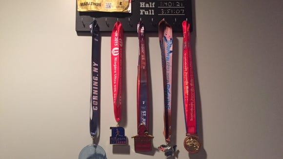 My new medal hanger with the medals from my ultramarathon, my three marathons and my current PR half marathon.