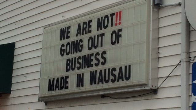 A sign on the retail store for Handcrafted Furniture emphasizes that the business will continue after the North Sixth Street location is closed.