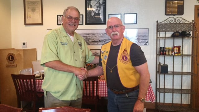 Chuck Sims, first vice district governor of Lions Club International, meets with Abilene Founders Lions Club member Ed Bunger at the group's Sept. 28 meeting, where they discussed the 100th anniversary of the Lions Club.