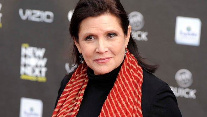 """FILE - This April 7, 2011, file photo, shows Carrie Fisher at the 2011 NewNowNext Awards in Los Angeles. Disney CEO Bob Iger said on March 23, 2017, that Fisher's performance as Princess Leia in """"The Last Jedi"""" remains unchanged. Fisher completed filming her role as Princess Leia in """"The Last Jedi"""" before her death following a heart attack in December. (AP Photo/Chris Pizzello, File)"""
