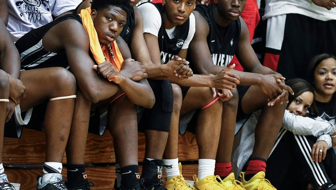 Team Penny forward Malcolm Dandridge (left) watches game action from the bench with teammates at the 2017 Nike Peach Jam in North Augusta, S.C.