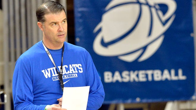 Kentucky head coach Matthew Mitchell looks on during practice for the NCAA women's college basketball tournament in Lexington, Ky., Friday, March 21, 2014. Kentucky plays Wright State in a first-round game Saturday.  (AP Photo/Timothy D. Easley)