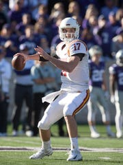 Iowa State Cyclones quarterback Kyle Kempt (17) drops back to pass during first-quarter action against the Kansas State Wildcats at Bill Snyder Family Stadium.
