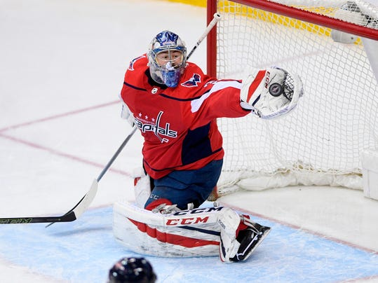 Washington Capitals goaltender Philipp Grubauer reaches for the puck during the third period of the team's NHL hockey game against the Nashville Predators, Thursday, April 5, 2018, in Washington. The Predators won 4-3. (AP Photo/Nick Wass)